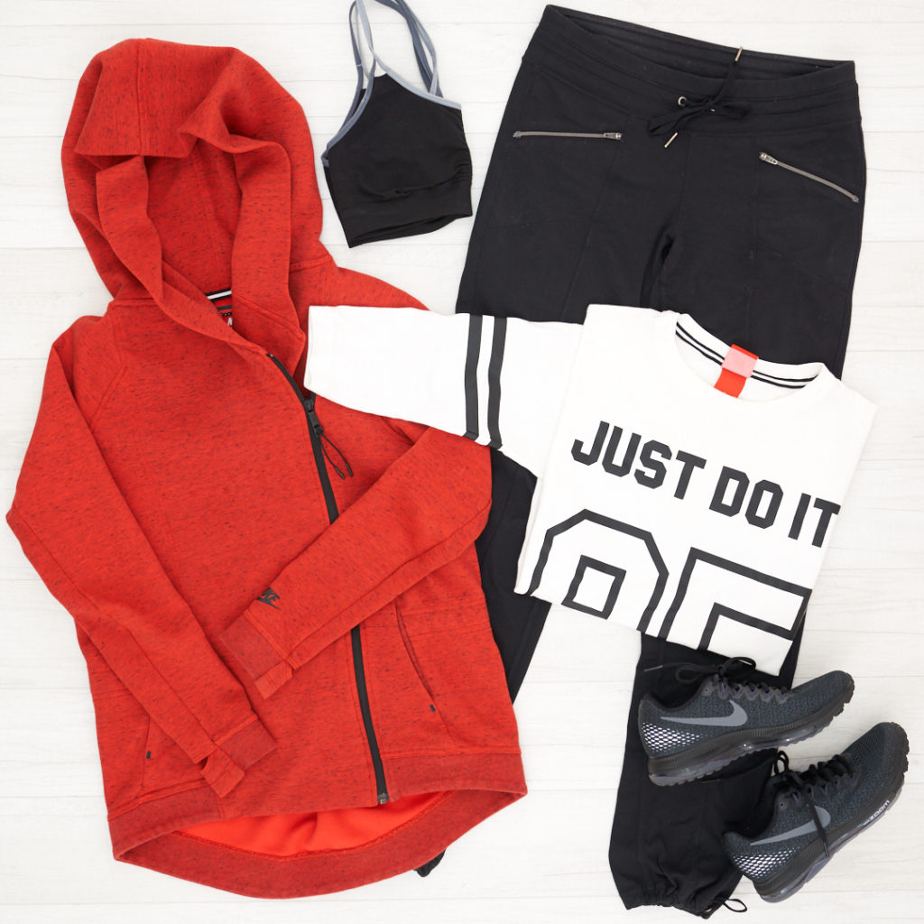 Athleta Metro Slouch pant paired with a Nike zip high/low orange jacket , Nike All Out Running Shoes, and a Just Do It Nike t-shirt.