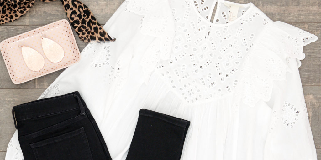 Spring 2018 Trend: White Eyelet Blouse. Flat Lay of White Eyelet Blouse and Black Jeans