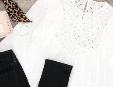 Spring 2018 Trend: White Eyelet Blouse. Flat Lay of White Eyelet Blouse and Black Jeans