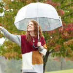 Picture of me holding umbrella in the rain and reaching out to the rain