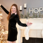 Photo of me reaching to the top of the tree in my velvet dress
