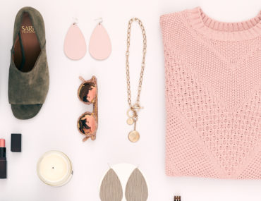 Flat Lay of Sweater, Shoes, Necklace, Candle and Sunglasses
