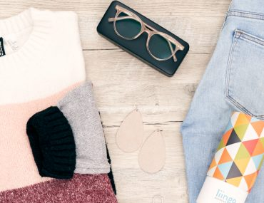 Flat lat photo of outfit and eyeglasses