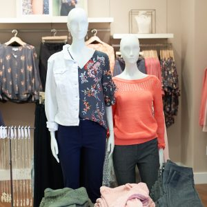 Photo of two mannequins in the front of the store