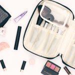 Flat Lay of Ellis James Desings Makeup Brush Bag and Makeup all around it
