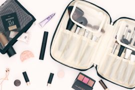 Flat Lay of Ellis James Desings Makeup Brush Bag and Makeup all around it