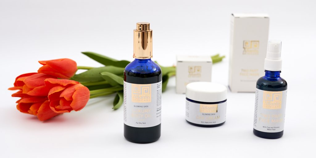 FLat lay of products for Atlantis Skincare - Tulips in the background