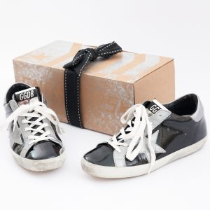 Flat Lay Photo of Golden Goose Sneakers and Packaging