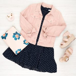 Flat Lay of outfit with pink denim jacket, pink espadrilles, and floral clutch