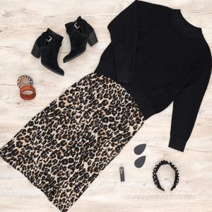 Leopard dress with black pull over sweater, black booties, black tear drop nickel and suede, dior lipstick, chunky bracklets and pearl headband