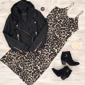 Edgy version of outfit with moto jacket, black booties, stacked rings, hoop earrings and a pearl hair clip