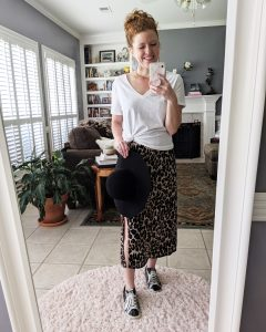Life-styled version of leopard slip dress with white tee over it and sneakers