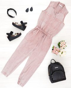 Flat Lay photo of pink jumpsuit, Brahmin Backpack, pearl headband, Nickel and Suede Earrings and OTBT Bushnell wedges