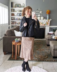 A mirrorshot of me wearing the slip on midi skirt and a black top with a black moto jacket over it. Paired it with black booties.