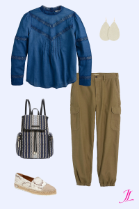 A photo of a blue long sleeve voile top, blue, white and black backpack, cargo khaki pants and nickel and suede pearl leather earrings.