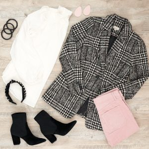 Flat lay photo of blazer and white clip dot blouse and pink skinny jeans and high heel booties